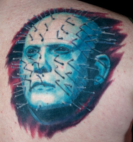 Upper Back Nice Pinhead Face Tattoo Idea