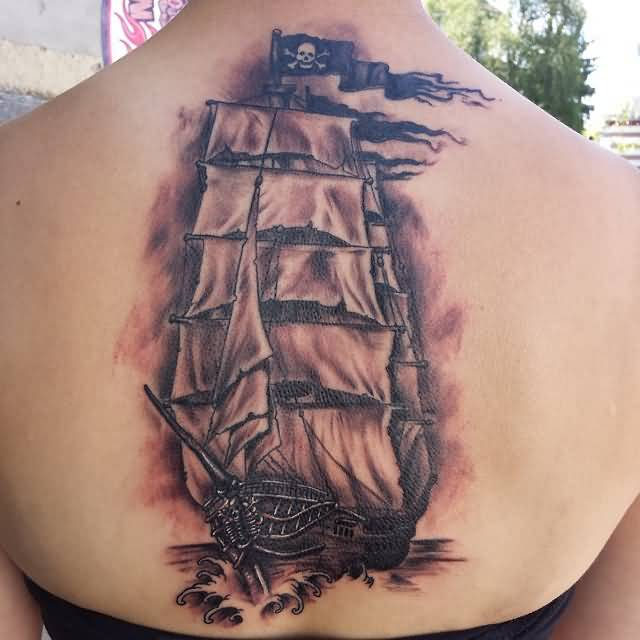 Upper Back Realistic And Awesome Jolly Roger Pirate Ship Tattoo