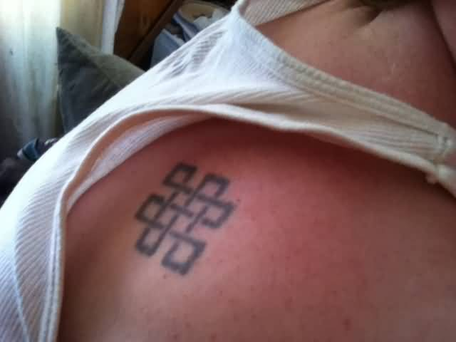 Upper Back Simple Black Endless Knot Tattoo