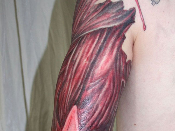 Upper Sleeve Ripped Skin Muscles Tattoo Design Idea