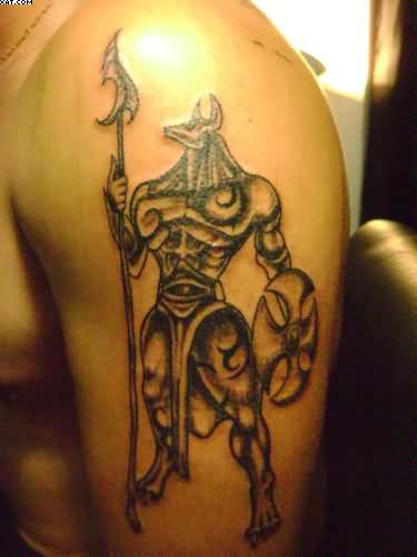 Upper Sleeve With Scarification Egyptian Warrior Tattoo On Shoulder