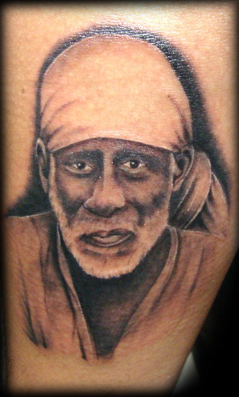 Very Famous Shining Photo Of Sai Baba Face Tattoo