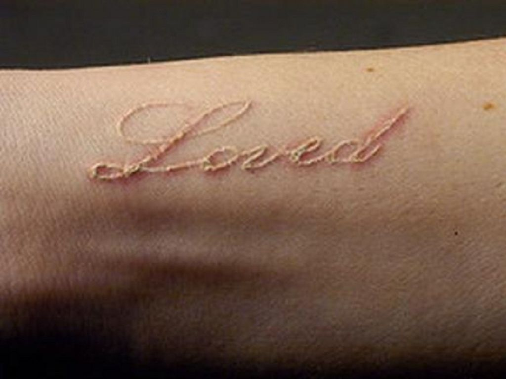 White Ink Loved Love Text Tattoo