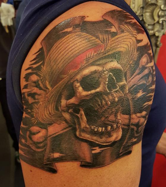 Women Show Amazing Jolly Roger Skull Tattoo