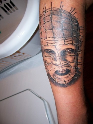 Wonderful Classy And Nice Pinhead Face Tattoo