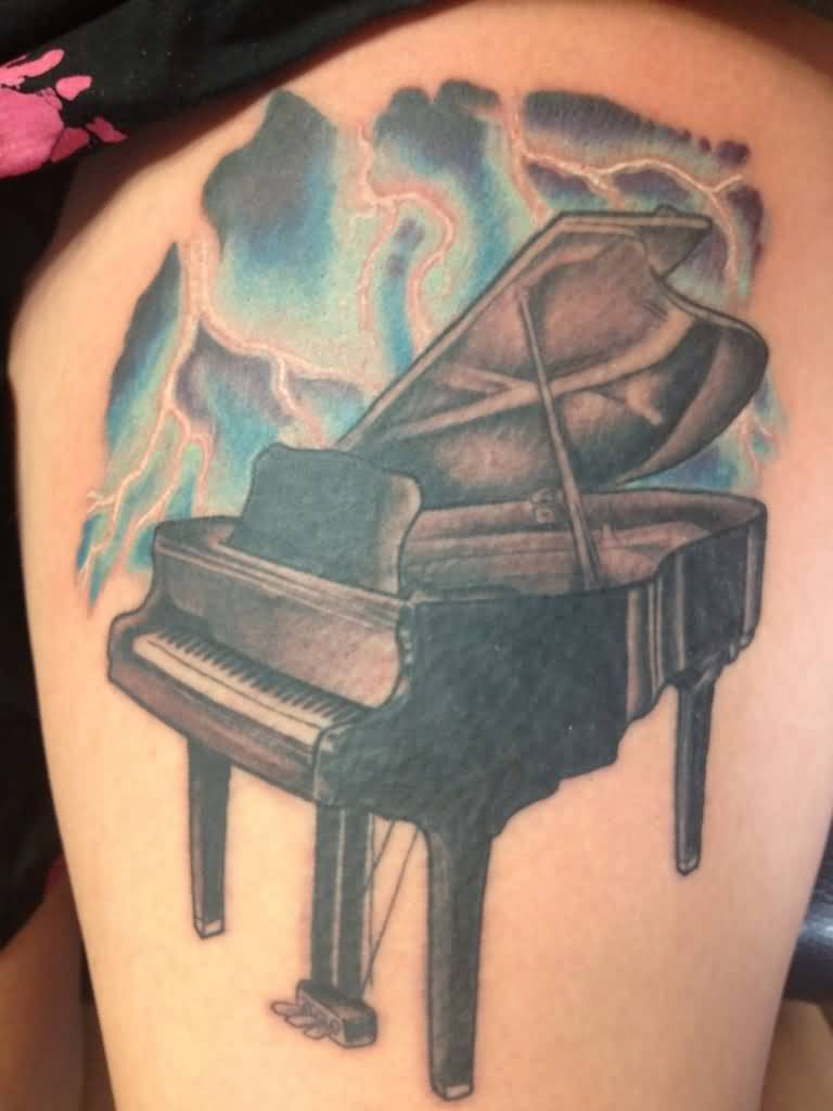 Wonderful Grand Piano Tattoo Design Idea On Thigh