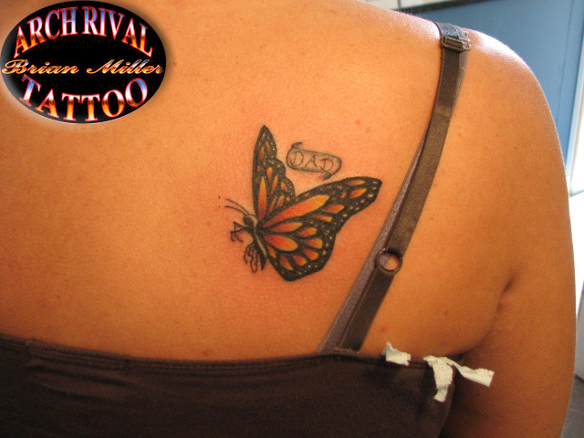 Wonderful Nice Flying Monarch Butterfly Tattoo With Dad Word