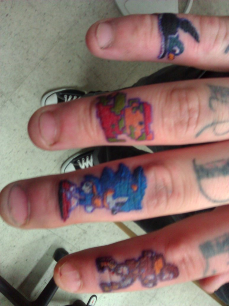 All Famous Cartoons 8 Bit Style Mario And Sonic Tattoo O n Finger