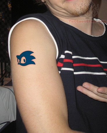 Blue Ink Nice Small Sonic Face Tattoo On Men Bicep