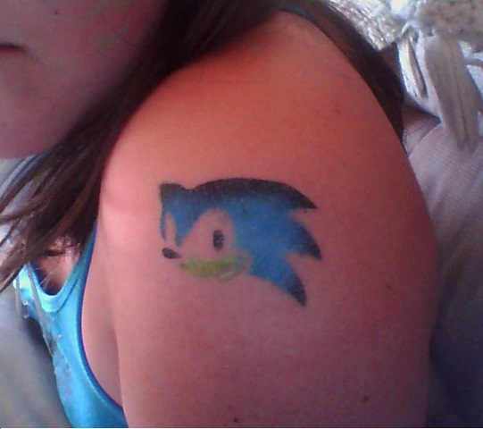 Girl Show Nice Sonic Face Tattoo Make On Shoulder