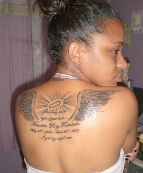 Girl Upper Back Amazing Remembrance Angel Wings And Quote Tattoo