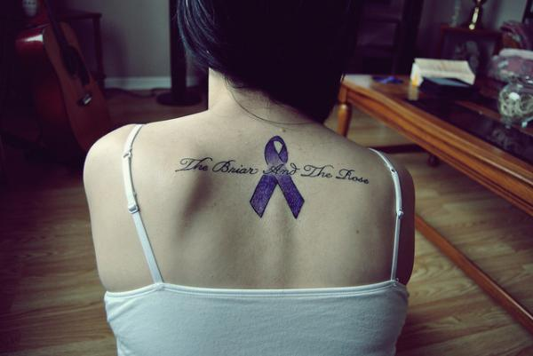 Girl Upper Back Remembrance Ribbon With Letters Tattoo