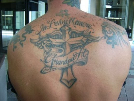Grey Ink Nice Remembrance Cross And Banner Tattoo