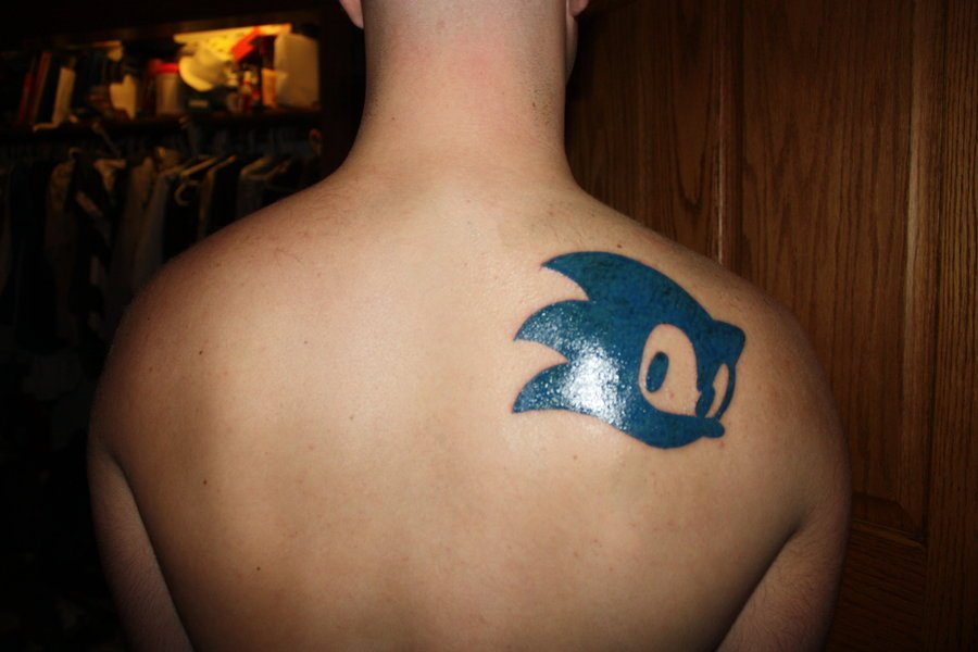 Men Upper Back Blue Ink Sonic Face Tattoo