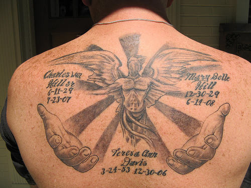 Nice Big Angel Wings Remembrance Tattoo With Letters