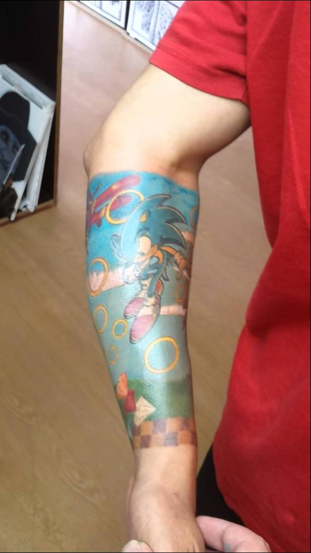 Nice Rings Sonic Cartoon Tattoo Design On Lower Sleeve