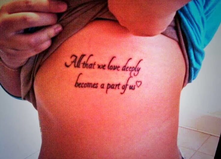 girl Show Her Remembrance Quote Tattoo On Rib Side