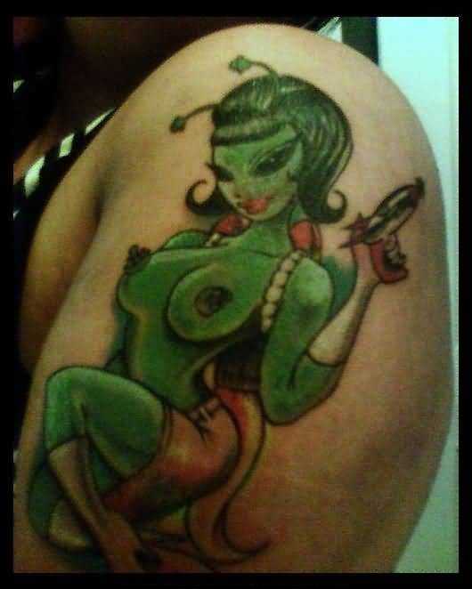 Green Ink Alien Tattoo