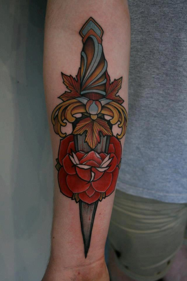 Nice Rose Dagger Tattoo