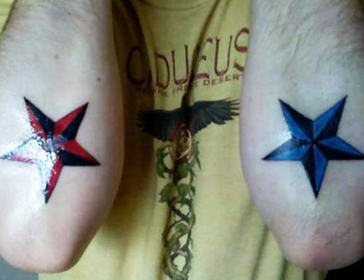 Red And Blue Ink Army Stars Tattoo